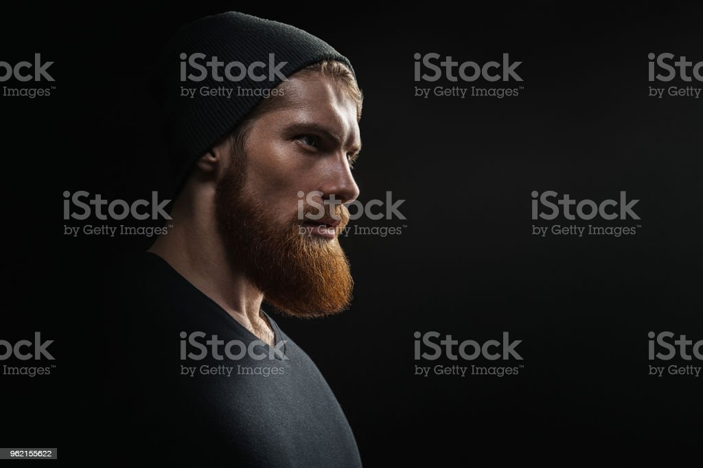 Silhouette of young bearded man hipster stock photo