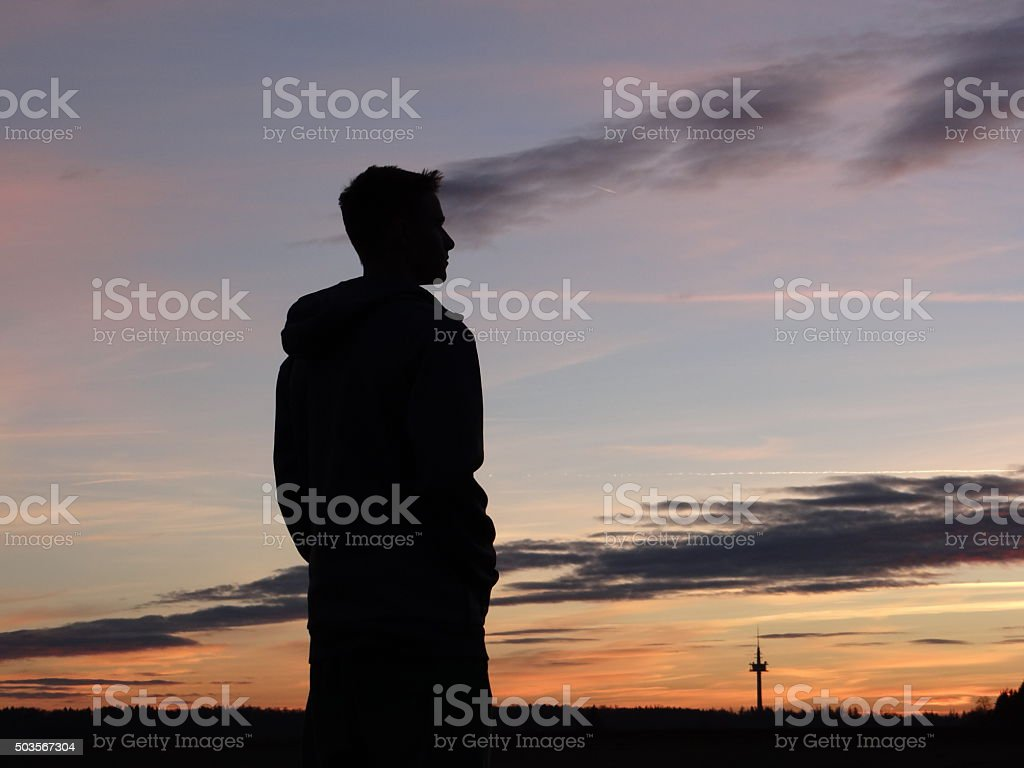 Silhouette of young boy stock photo