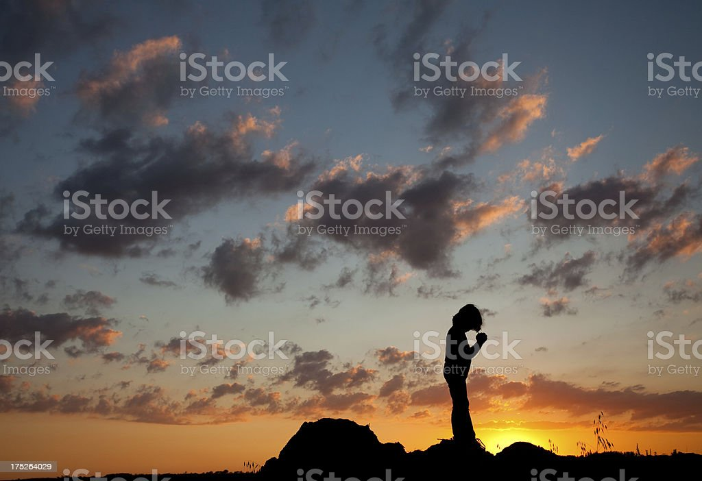 Silhouette of Young Boy Praying royalty-free stock photo