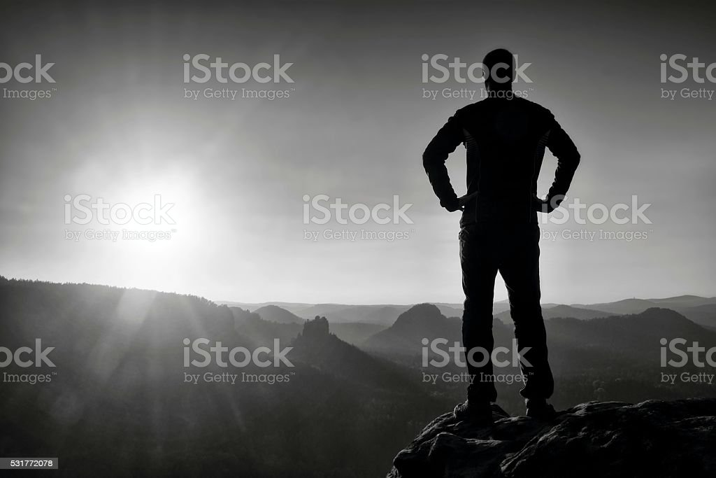 Silhouette of Young Confident and Powerful Man stand stock photo