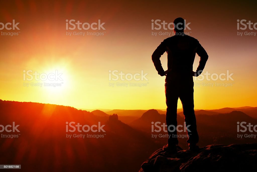 Silhouette of Young Confident and Powerful Man Standing withSpace stock photo