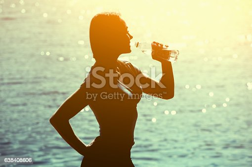 638628530 istock photo Silhouette of young female athlete in tracksuit. 638408606