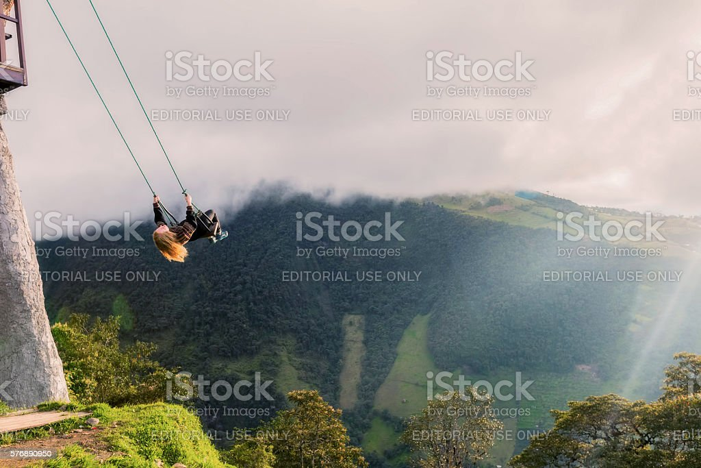 Silhouette Of Young Happy Blonde Woman On A Swing stock photo