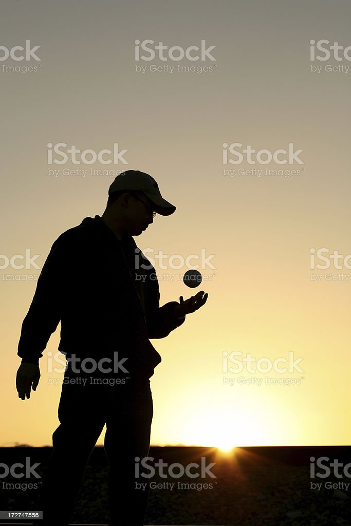 silhouette of young man holding baseball royalty-free stock photo