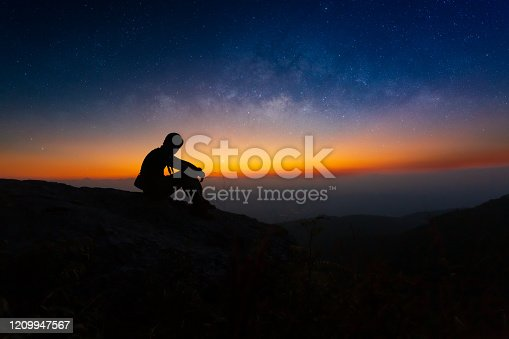 867295412 istock photo Silhouette of Young man sitting on top mountain view alone at during sunrise Look at the sky View the stars and the Milky Way in the lonely night,copy space,Bolivia, South America, Star - Space, Astronomy, Staring 1209947567