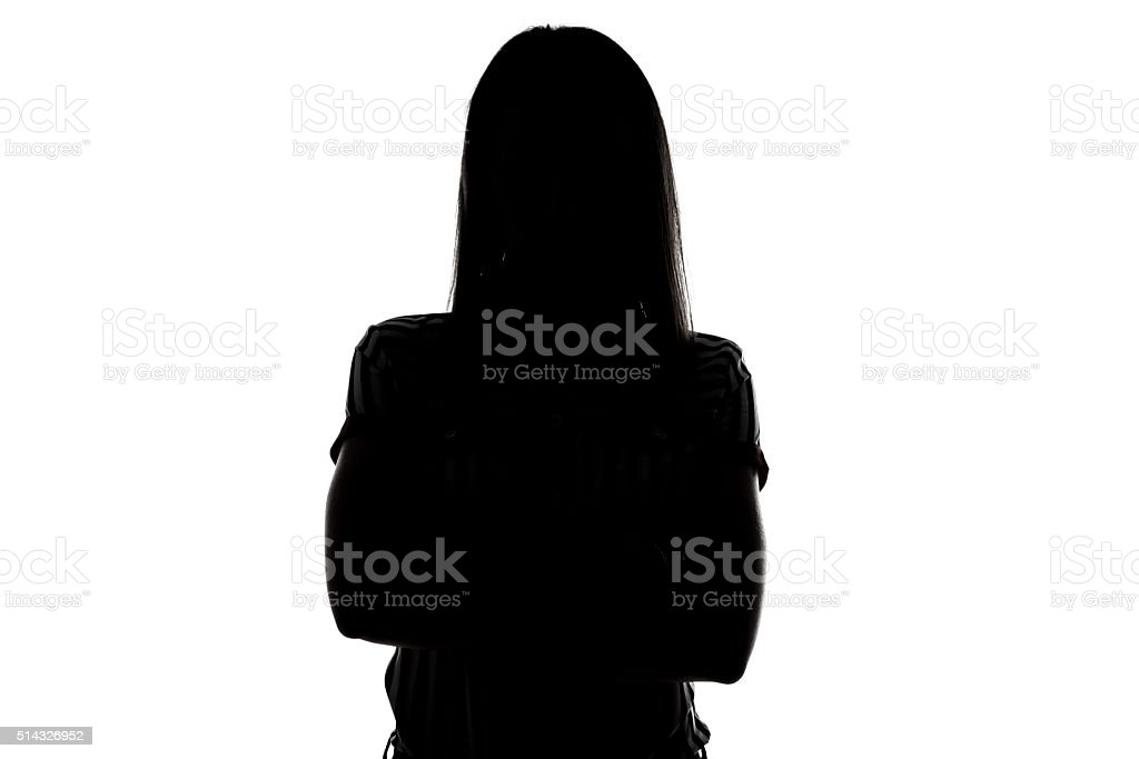 Silhouette of young woman stock photo