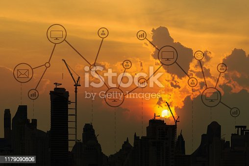 1155541483istockphoto Silhouette off sunset aerial view of smart city concept at dusk, global network connection in business district with futuristic concept 1179090806