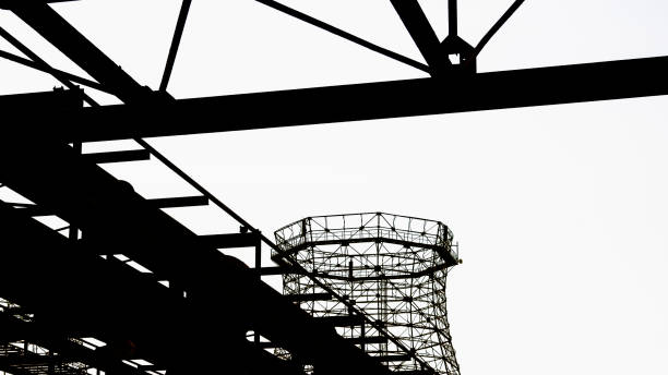 Silhouette old cooling tower stock photo