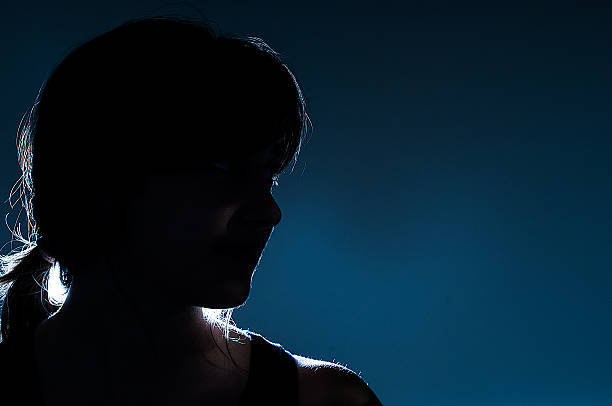 Silhouette on blue background stock photo