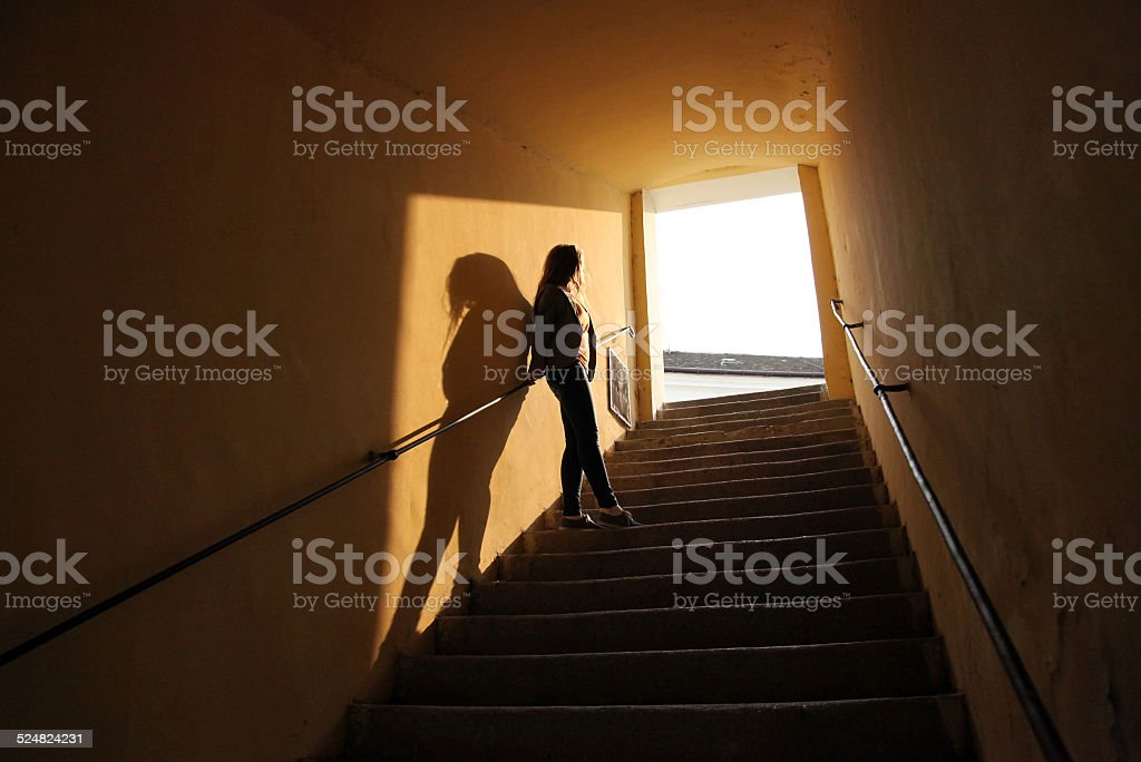 silhouette on the stairs stock photo