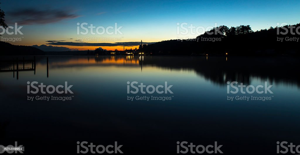 silhouette on the werbellinsee at dawn light stock photo