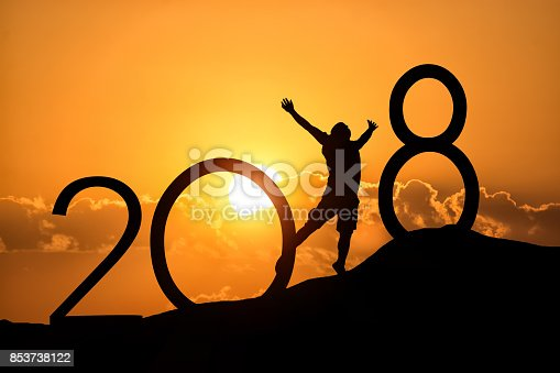 istock Silhouette person jumping over 2018 on the hill at sunset 853738122