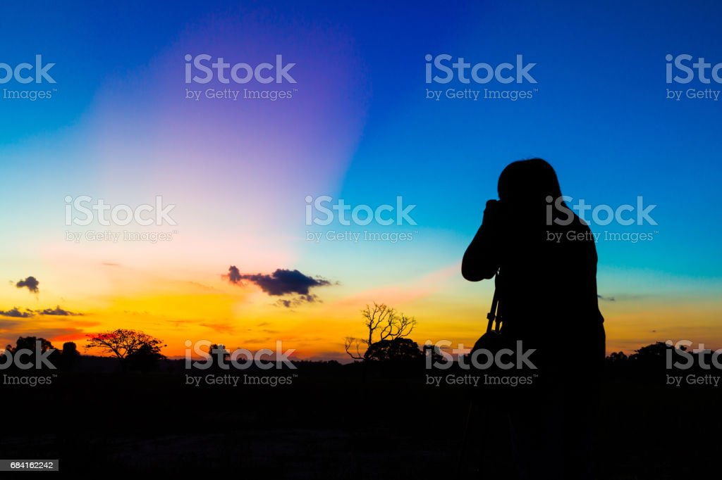 Silhouette photographer with sunset foto stock royalty-free