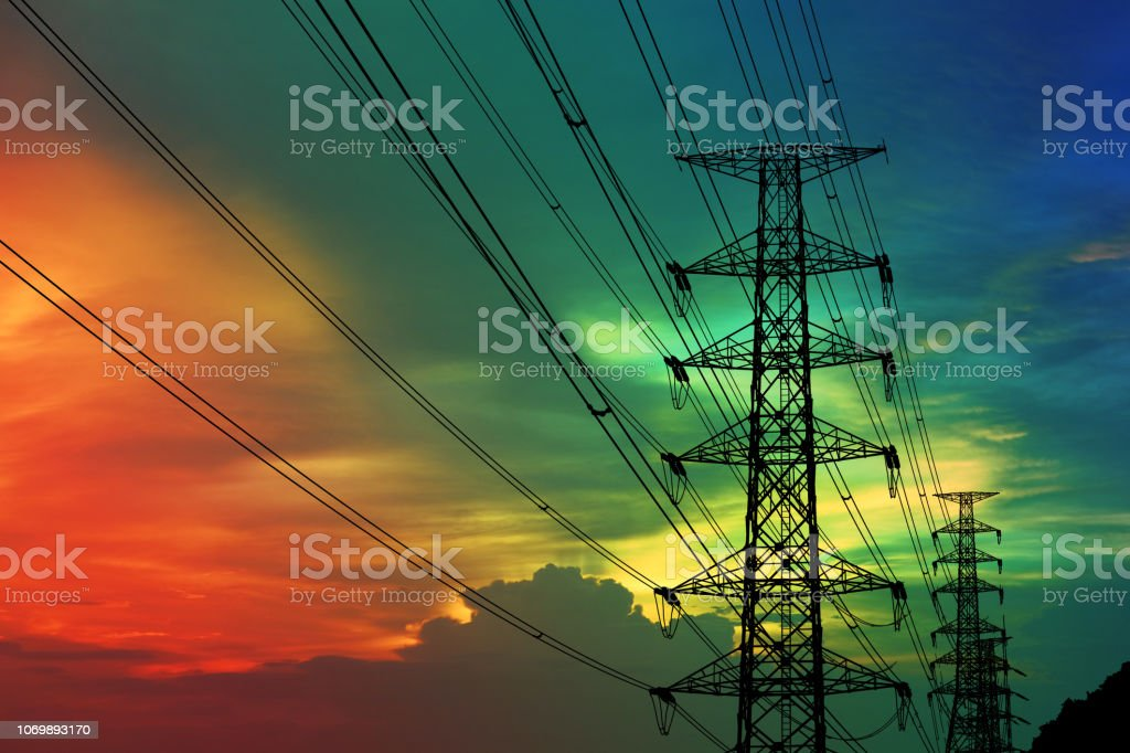 silhouette power electric pole and electric line and colorful sunset...
