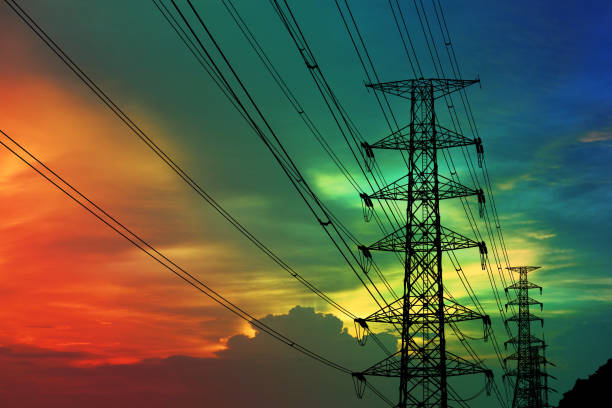silhouette power electric pole and electric line colorful sunset sky stock photo