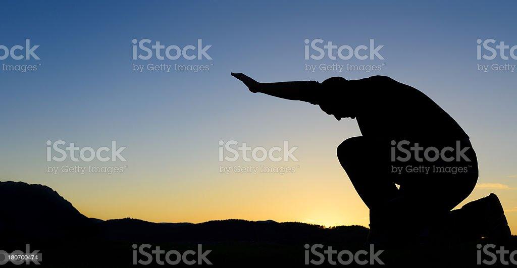 silhouette praying royalty-free stock photo