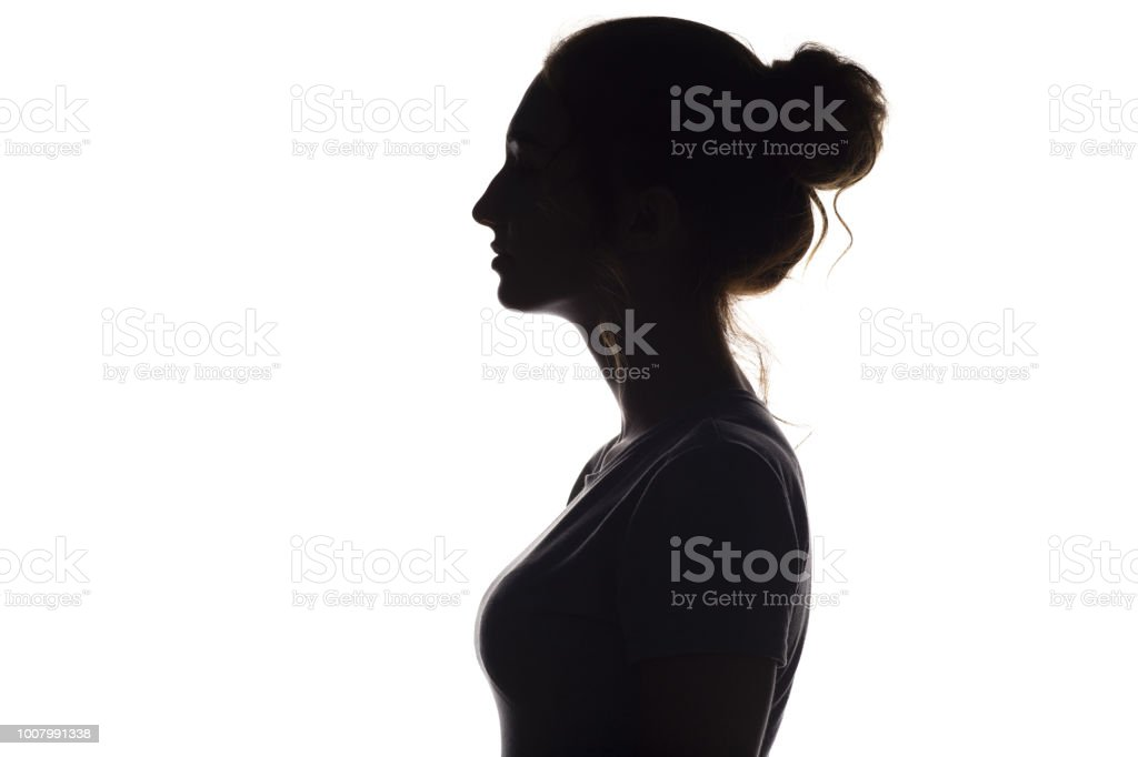 silhouette profile of beautiful girl on a white isolated background - Royalty-free Adolescence Stock Photo