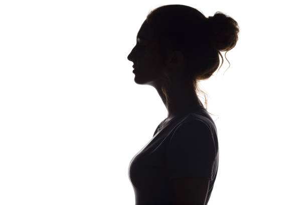 silhouette profile of beautiful girl on a white isolated background stock photo