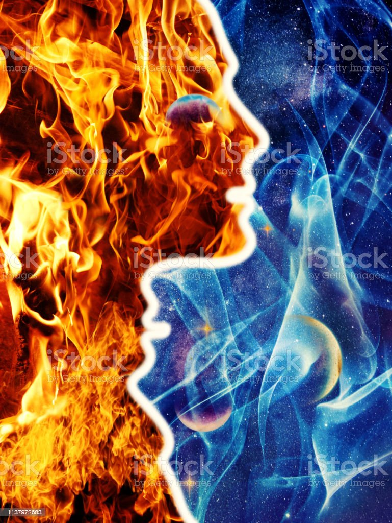 Silhouette Profile portrait man woman souls perfect matching union of two different and opposite world flame and ice. stock photo