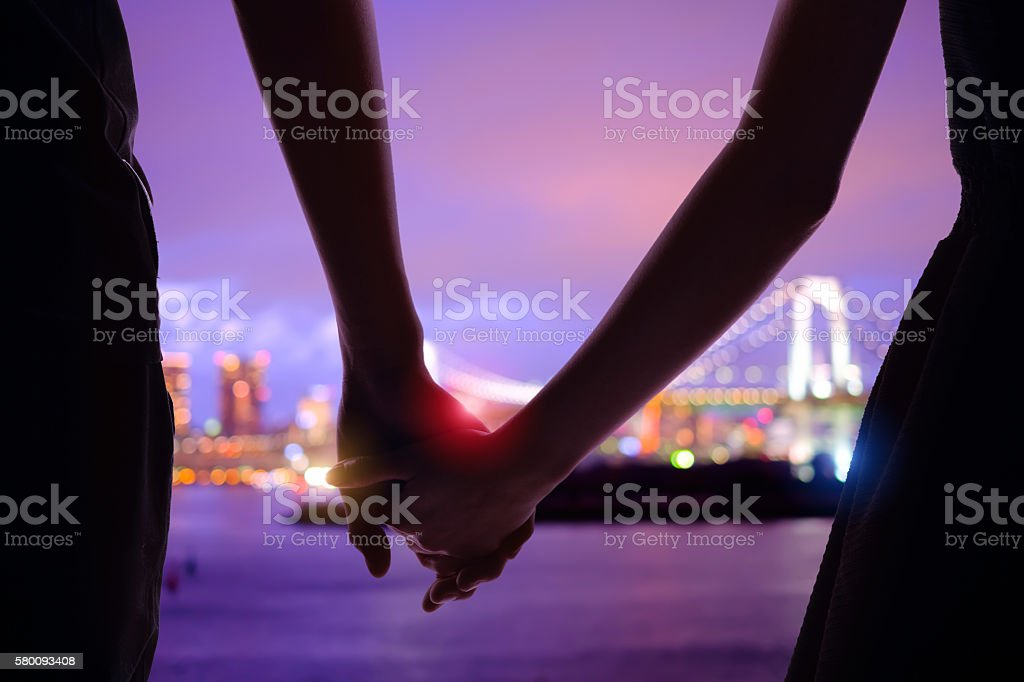 silhouette romantic lovers with Odaiba stock photo