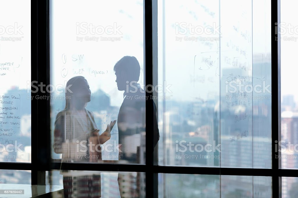 Silhouette shadows of business people talking in office stock photo