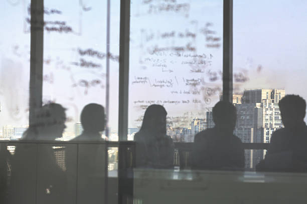 Silhouette shadows of business team meeting in office Silhouette shadows of business team meeting in office governing board stock pictures, royalty-free photos & images