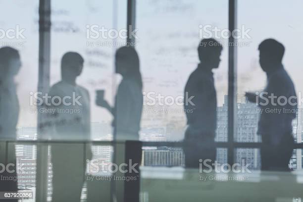 Silhouette shadows of business team meeting in office picture id637920356?b=1&k=6&m=637920356&s=612x612&h=juraczofjpjk2u2uovlwzlrgpinpy rr9j79ycucsec=