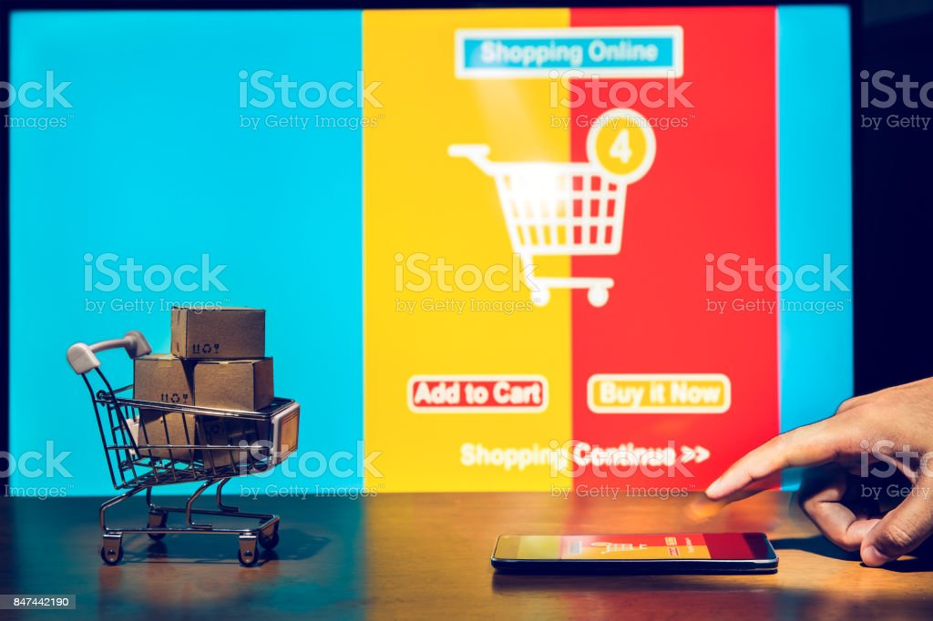 Silhouette shopping background, Cartons in shopping cart with ad order shopping sceen background, shopping online concept, Business abount internet of thing background. stock photo