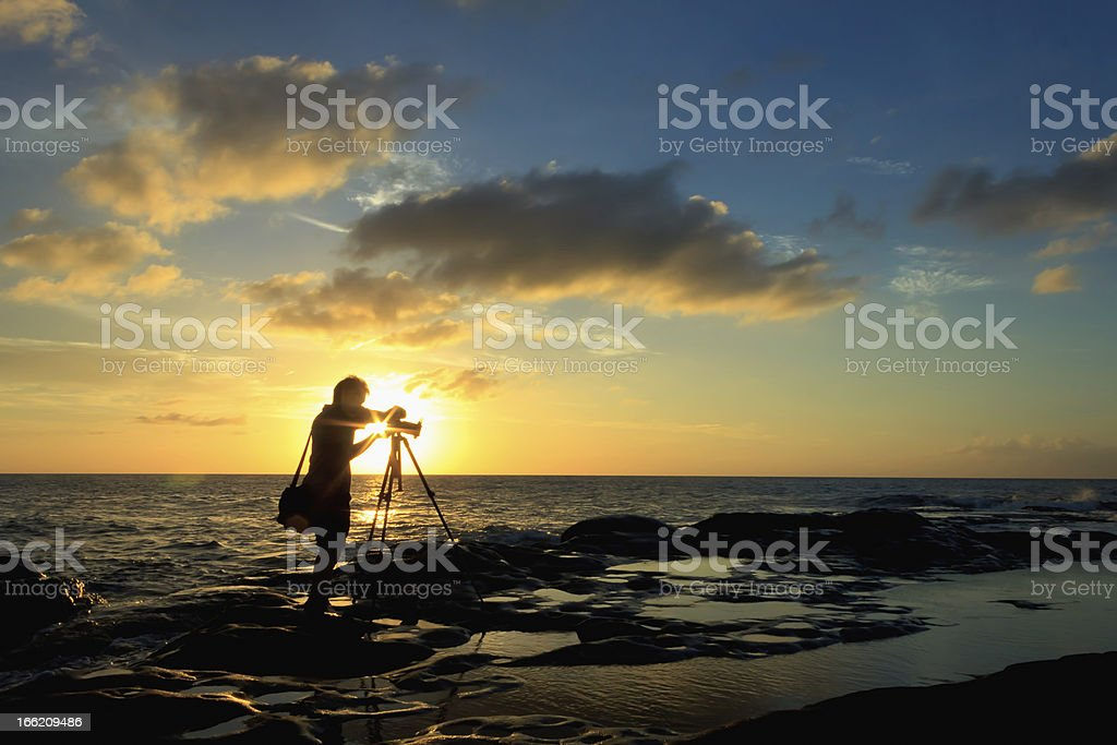 Silhouette shot of a photographer at sunset royalty-free stock photo