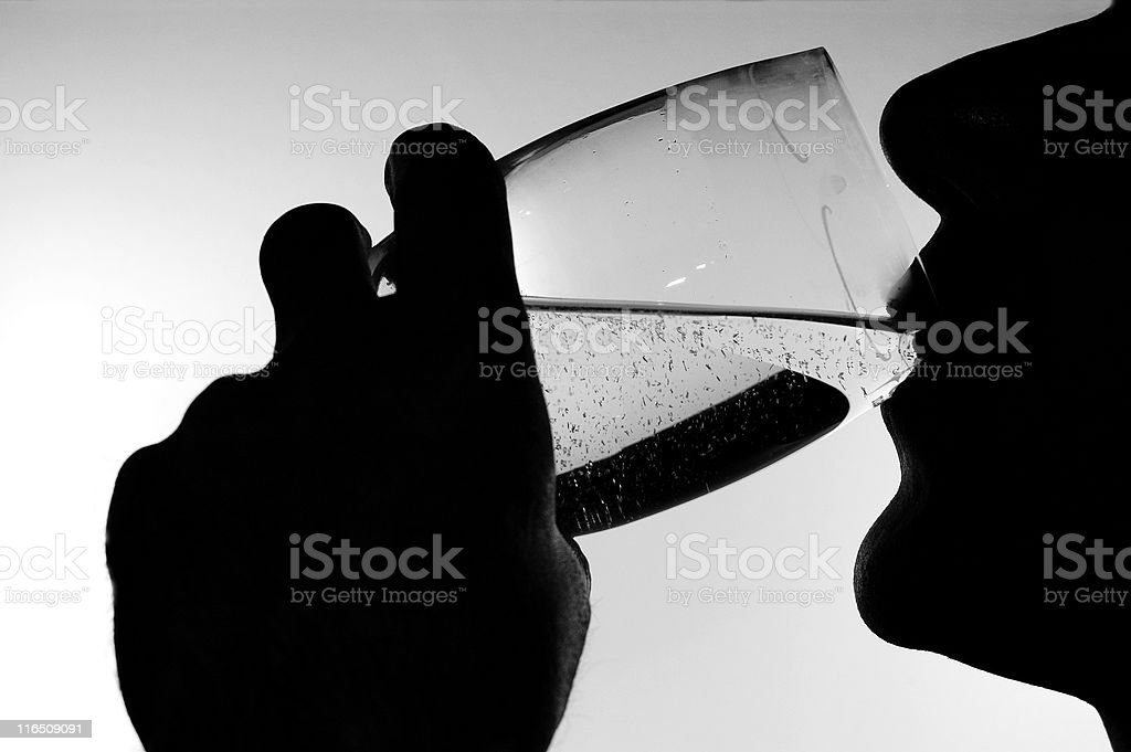 Silhouette showing a person drinking water stock photo