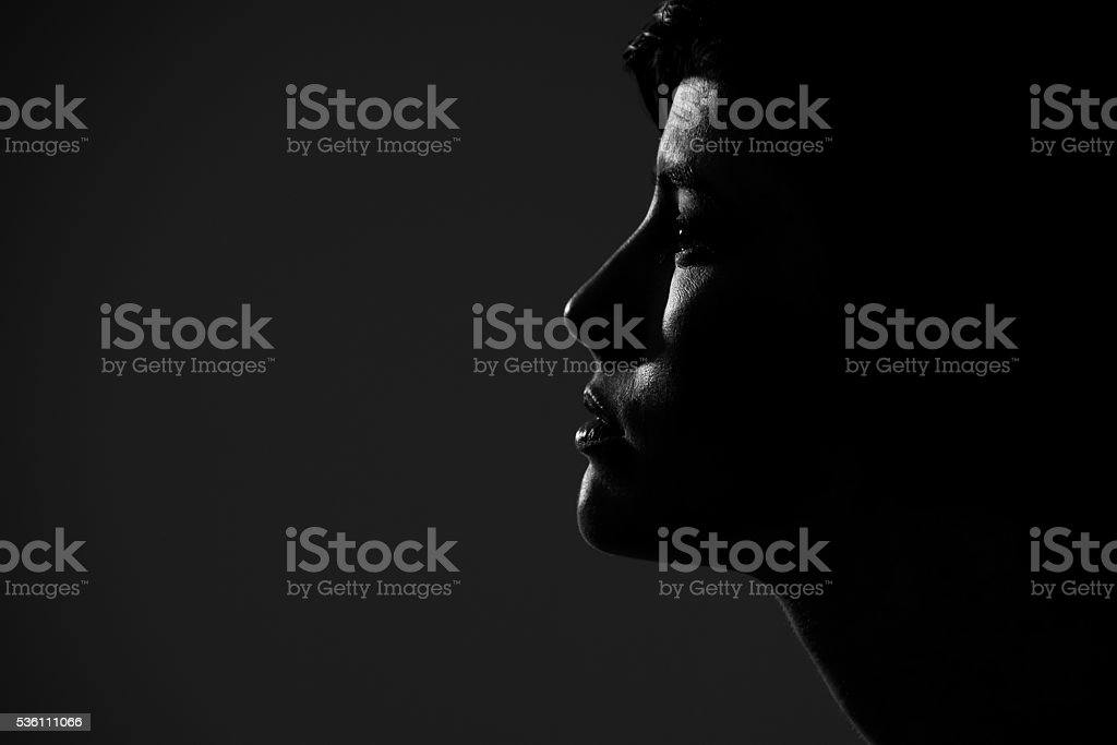 Silhouette side portrait of young pretty woman looking away stock photo