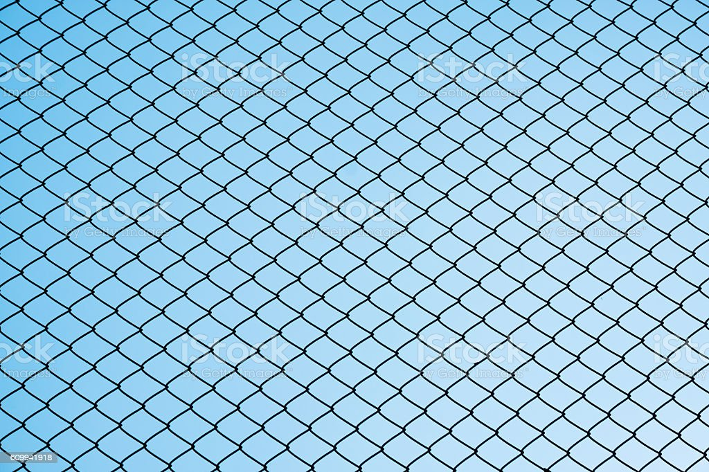 Silhouette steel net wire against gradient clear blue sky stock photo