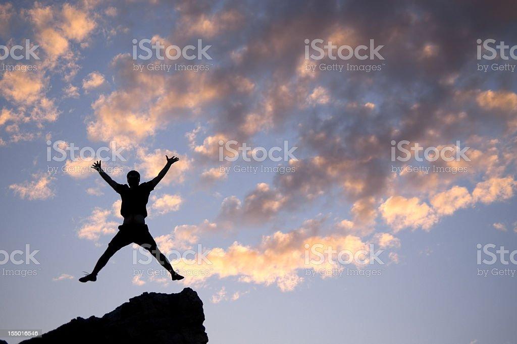 silhouette sunset jump spread eagle stock photo