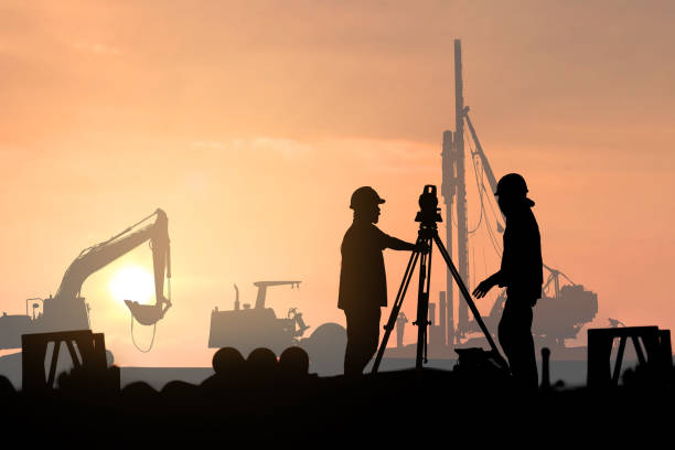 silhouette survey engineer in construction site use theodolite mark a concrete pile co ordinate stock photo