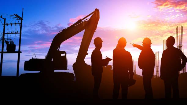 シルエットのチーム エンジニア - 建設作業員 ストックフォトと画像