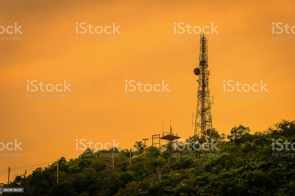 Silhouette telecommunications antenna for mobile phone at sunset stock photo