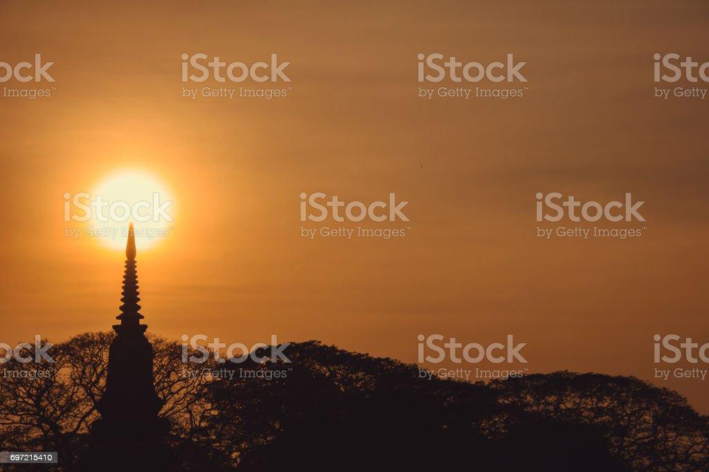 silhouette Thai pagoda and tree bush at sunset, Ayutthaya, Thailand. stock photo