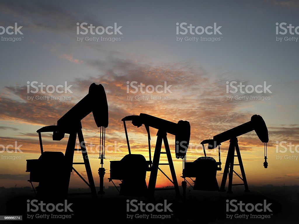 Silhouette three oil pumps stock photo