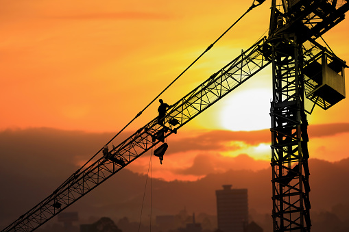 Silhouette Tower Crane Construction With Worker In Sunset And Copy Space Add Text Stock Photo - Download Image Now