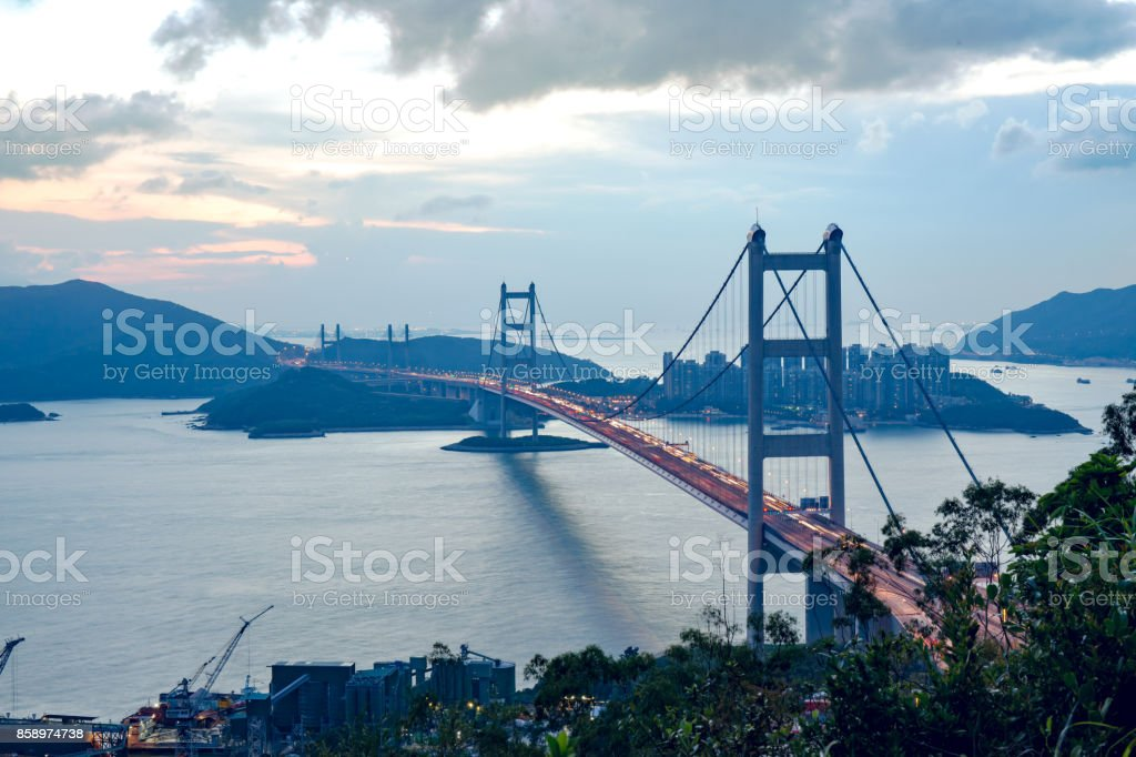 silhouette Tsing Ma Bridge at Hong Kong, China at sunset stock photo