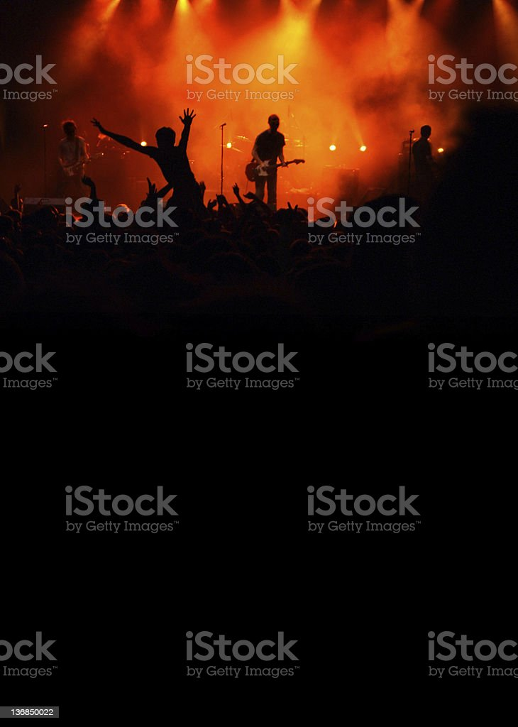 Silhouette view of a band and concert goers at rock concert royalty-free stock photo