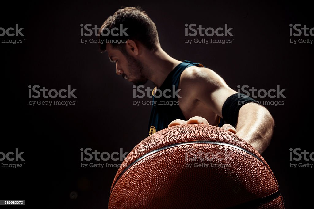 Silhouette view of a basketball player holding basket ball on stok fotoğrafı