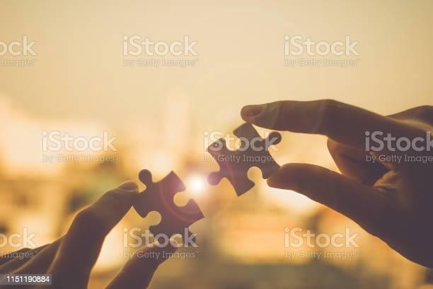 Silhouette woman hands connecting couple puzzle piece against sunrise picture id1151190884?b=1&k=6&m=1151190884&s=612x612&h=qrvvphr8xaut9cawtwegdqxvfotblsj tmffpkgp0 s=