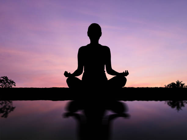 Silhouette woman meditate stock photo