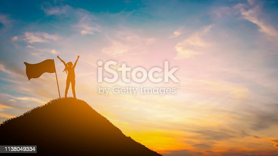 Silhouette woman on top hill in sunet