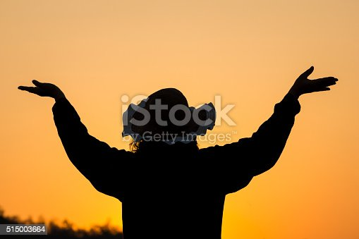 1127798356 istock photo Silhouette woman open hands up to sunset sky. 515003664