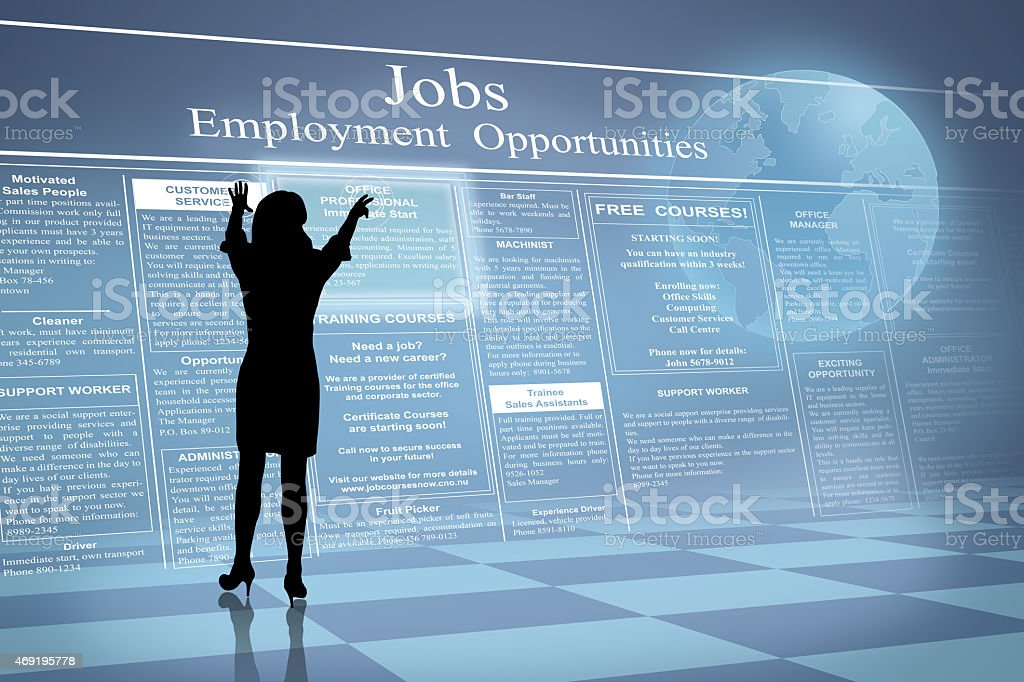 Silhouette Woman reading online job ads stock photo