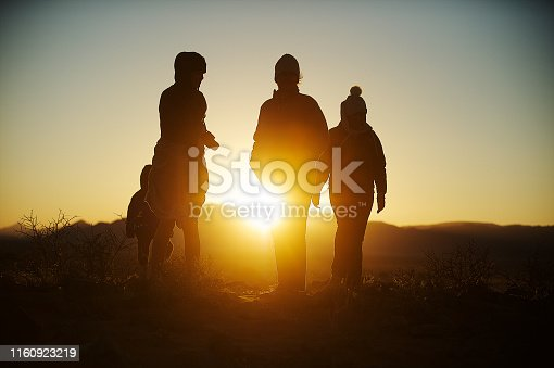 Silhouette women with hats and girl at sunrise Namib Desert Namibia Africa