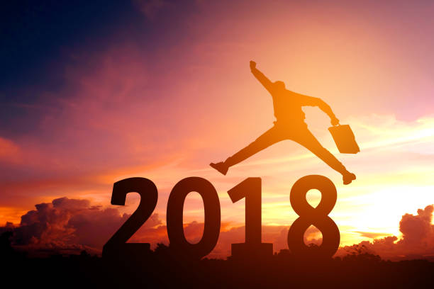 silhouette young business man happy for 2018 new year - new year day stock photos and pictures