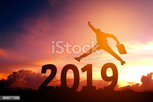 istock Silhouette young business man Happy for 2018 new year 939377056